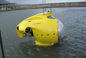 Small Yellow Submarine Floating On The Surface